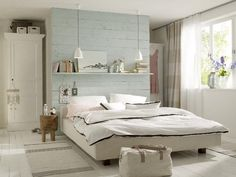 Love the painted wooden headboard and ceiling hung bedside lights.