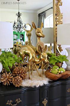 Fall vignette- brass deer, white fur, hedge apples, twig balls  ||  from dimplesandtangles.com
