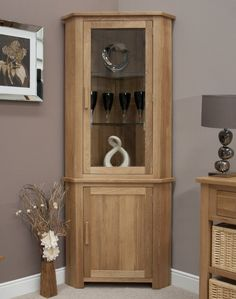 Attractive Furniture Beautiful Corner Cabinet For Living Room From Maple Wood Material  Using Glass Door Cabinets And Wooden Pull Handles Nearby Stainless Picture  Frame ...