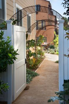 Grace Design    love the fence and arbor  to the garden