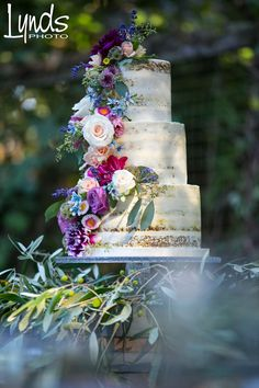Semi Naked Carrot Wedding Cake with Fresh Flowers put on by us. Photo by Lynds Photography. Cake by Let's Do Cake!