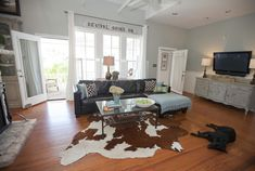 brown leather couch...cowhide rug  Austin Modern Farmhouse - eclectic - living room - austin - Van Wicklen Design