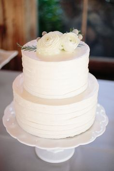 Classic wedding cake idea - white two-tier, buttercream frosted cake with flower cake topper {Riverland Studios}