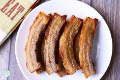 The best and easiest way to cook pork belly strips is to bake the slices in the oven until crispy on the outside and tender on the inside.
