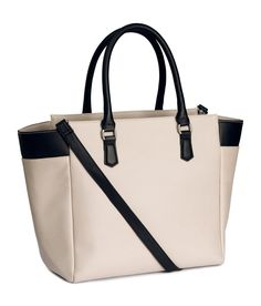 Light taupe tote bag with detachable shoulder strap & contrasting black accents. | H&M Accessories
