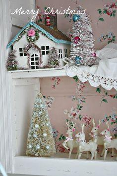 Bottle brush Christmas trees, tiny white vintage reindeer, and putz house.