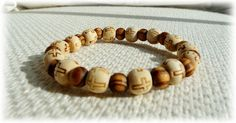 Mens stretch bracelet with natural large cross-printed wooden beads £16.75