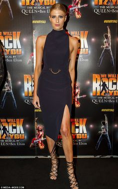 Setting the stakes high: Erin Holland stunned on Thursday night as she slipped in a figure-hugging gown which flaunted her toned legs through its high front split for the Sydney premiere of We Will Rock You