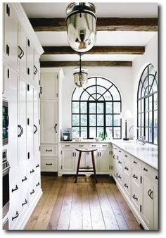 White, galley style, large windows