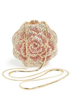 This sparkly pink and gold rosette clutch is simply beautiful.