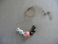 coloured earthenware clay beads + natural leather cord