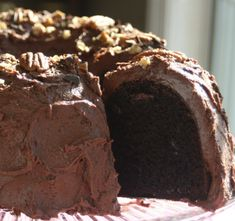 This is a chocoholics dream cake. This is very impressive and delicious. Either dust powdered sugar on it, or try my Recipe #200078 which goes perfectly with it.