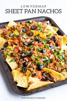 Easy Low FODMAP Sheet Pan Nachos - my take on the popular Tex-Mex appetizer filled with crunchy tortilla chips tasty taco meat melty cheese and all the FODMAP-friendly toppings More easy low FODMAP recipes at Nachos, Tex Mex, Easy Healthy Recipes, Easy Meals, Food Map, Fodmap Recipes, Fodmap Foods, Low Fodmap, Tortilla Chips