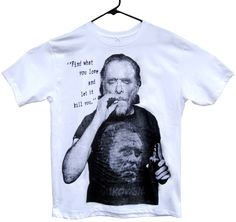 """CHARLES BUKOWSKI T-Shirt:   """"Find what you love and let it kill you.""""  Printed on a soft white cotton tee.  Our unisex tees are 4.2 oz., preshrunk 100% combed ring-spun cotton.  Available Sizes: S, M, L, XL, 2XL, 3XL"""