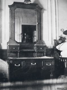 """This photo shows the interior of Father Browne's cabin. According to Father O'Donnell: """"When Ballard found the Titanic, he discovered that it was in two pieces, nearly half a mile apart. The ship split in two right through Father Browne's suite of rooms. He was 37a. The matching room on the other side of the grand staircase was inhabited by Thomas Andrews, the builder of Titanic from Harland and Wolf."""""""