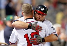 Brian McCann hugs Chipper Jones