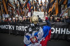 Img_4675 A woman draped in a separatist flag of the self-proclaimed Donetsk People's Republic rallies the anti-Euromaidan march in Moscow. Image: Mashable, Evgeny Feldman