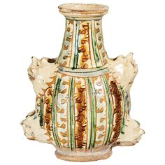 Italian Earthenware Pilgrim's Bottle  North Italian, 16th century  Of flaring form, with pierced mask handles for suspension, coverd with white slip and decorated in sgraffiago, with rows of vertical bands of ornament painted in green and yellow. Height 7 1/4 inches (18 cm).