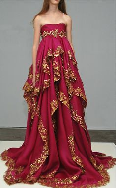 Marchesa.  Stunning claret colored, empire waist gown.  Golden embroidery at waist.  Multiple layers also embroidered with gold.  Indian inspiration.