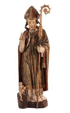 Höhe: 102 cm. Deutschland, Anfang 17. Jahrhundert. In Bischofsgewand und Chormantel, auf mitgeschnitztem Rasensockel im Kontrapost stehend mit rechtem...