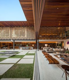 jacobsen arquitetura clads GAF house in são paulo with alternating timber panels