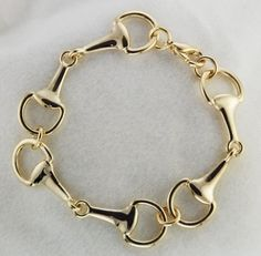 Gold Bit Bracelet https://www.etsy.com/listing/187593245/sale-gold-snaffle-three-horse-bit