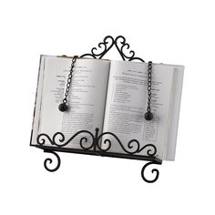 The best cookbook holder ever features scrolled metal and heavy page holders.