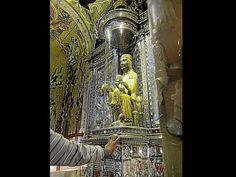 Excerpted from Our Lady of Montserrat website information:    According to Catholic tradition, the statue of the Black Virgin of Montserrat was carved by St. Luke around 50 AD and brought to Spain. It was later hidden from the Moors in a cave (Santa Cova, the Holy Grotto), where it was rediscovered in 880 AD.