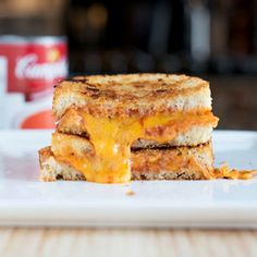 Day 3 of National Grilled Cheese Month brings together two classics in the Tomato Soup Grilled Cheese.