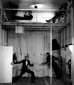 Bruce Mclean 'Nice Style' 1974 performed at the Garage gallery London, donning dinner suits and striking exaggerated poses on a makeshift scaffolding palazzo.