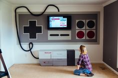 DIY Nintendo - This highly creative DIY Nintendo home entertainment system consumes the entire wall of Tylerfulltilt's living room and looks just like a ret. Home Entertainment, Nintendo Room, Nintendo Controller, Super Nintendo, Nintendo Games, Arcade Games, Deco Gamer, Home Theater Setup, Video Game Rooms