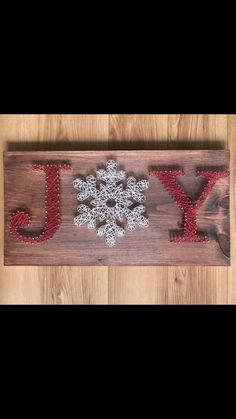 Beautiful string art so pretty for the holidays. #wood #rustic #holidays #christmas #decor #joy #affiliate