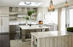 Clean, crisp, bright: A white kitchen is an ideal setting for the home cook, whether your taste is classic or contemporary, urbane or rustic. The use of white not only makes a kitchen look bigger and airier, it also provides a clean canvas for showcasing other elements to create an inviting, enchanting, and functional kitchen.