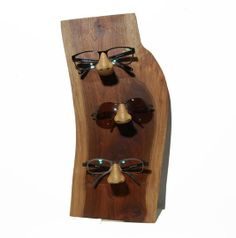 b07e03416b Wall mounted sunglass display rack Each noses are hand carved into the live  edge back panel and finished with food safe beeswax and oil.