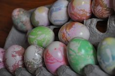 Marbleized Easter Eggs! Olive oil and Easter egg dye in a shallow plate and swirl the egg around!