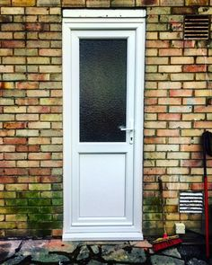 uPVC Liniar back door, frosted glass unit.