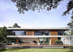 Clean geometric lines warm timber and huge windows make up this stunning home. by un__plugged