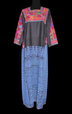 Africa | A young Sawarkah girl's dress | Sinai peninsula, Egypt | ca first half 20th century | Cotton and embroidery | These dresses with the blue embroidery were worn only by young girls before marriage. This tradition has disappeared since the 1980s.