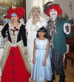 The Red Queen, The White Queen, The Mad Hatter, and Alice. All home made costumes either from sewing or putting things together from thrift shops and our closets. Alice's dress and top hat were ordered online.