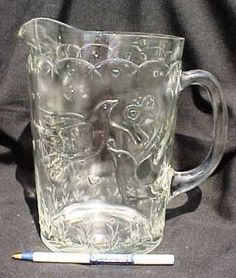 large glass pitcher with birds, hearts and flowers