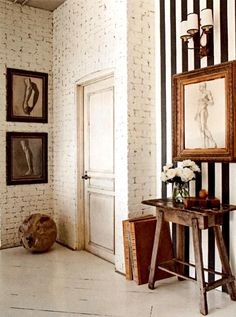 striped accent wall + chalky white painted brick