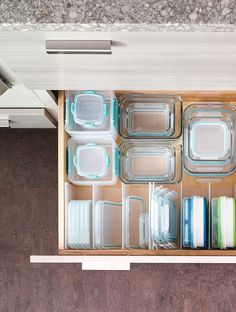 Keep food storage containers organized to make assembling school lunch quick and easy on busy mornings. Martha Stewart Living Kitchens only at The Home Depot provide customizable storage options for the whole family.