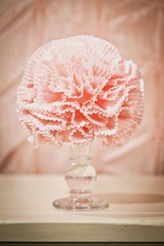 cupcake liner pom poms in a glass candlestick. so pretty! Such a good idea for wedding decorations!