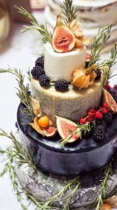 Stunning cake made from wheels of favorite cheeses // ARTELIER