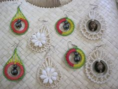 Earrings hand woven with dried panadanus and coconut leaves along with shells found ashore.