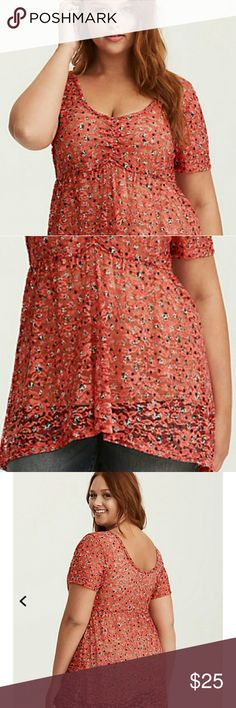 Floral Lace Babydoll Top This light weight, semi-sheer red and multi-color floral print lace has you feeling love struck. The cinched  v-neck front keeps eyes up top, while a babydoll hi-lo cut flares out where you want it. EUC torrid Tops