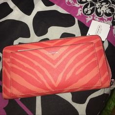 Coach Hot Orange wallet Beautiful Coach zebra hot orange wallet. New never used and needs a new lovely home. Coach Bags Wallets