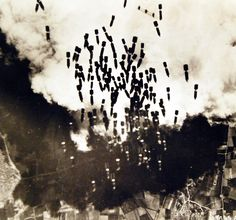 """Lot 11631-7: Allied Air Raids, Europe, WWII, 1943. Bombs from a B-17 """"Flying Fortress"""" plane falling on the Monserrato Airfield near Cagliari in Sardinia, 1943. U.S. Army Air Force Photograph. Courtesy of the Library of Congress."""