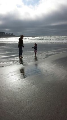 My daughter taking the time to listen to my granddaughter as she shows her a shell. Priceless parenting.