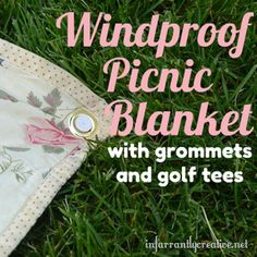 Punch grommets in the corner of a blanket and use golf tees to keep it in the ground!